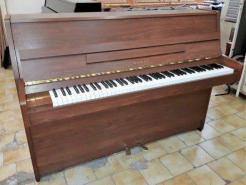 Piano droit d'occasion KAWAI CX5